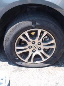 flat tire road trip AAA rescue