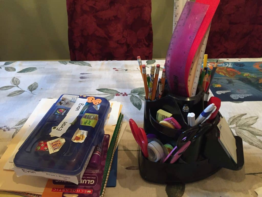school supplies on dining room table