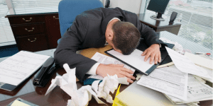 head on desk How Lack of Sleep Can Affect Your Business man office