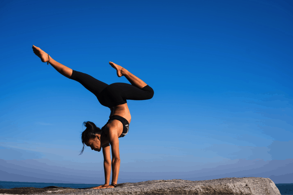 yoga post hand stand on rock