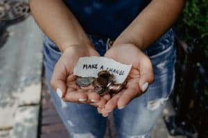kat-yukawa-754726-unsplash - hand with money and change coins