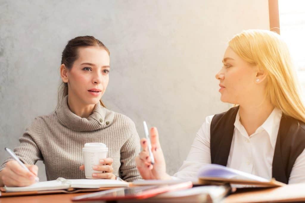 professional women talking coffee shop