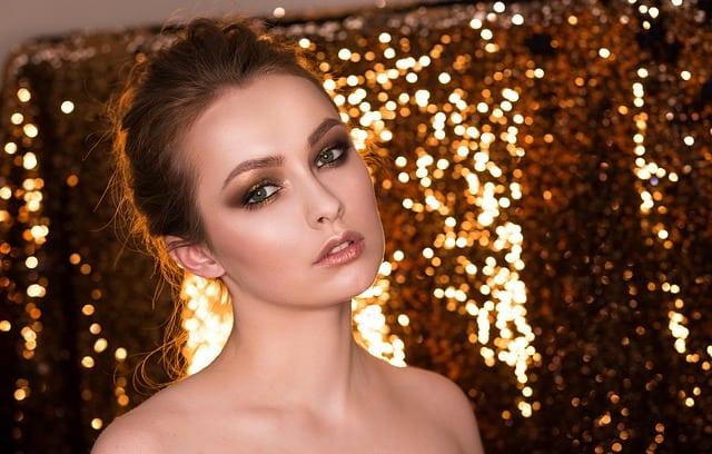 woman makeup glitter makeup for the holidays