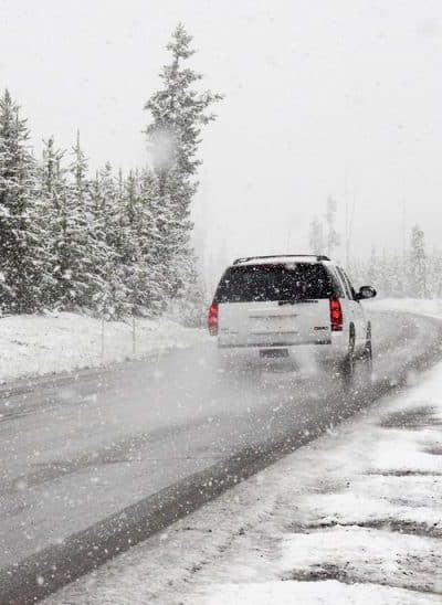 winter road safety tips to help keep you and your family safe during the holiday season - car on icy road highway