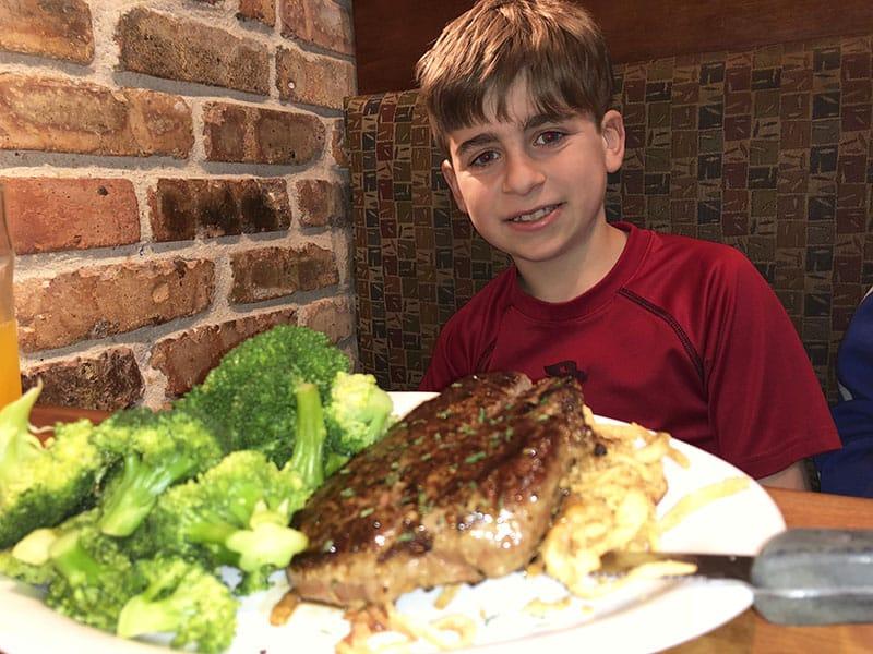Cheddar's Family Restaurant on a Budget - Kid Eating Sirloin Steak