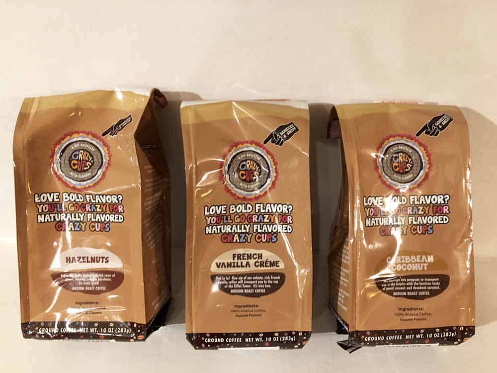 Three 10 ounce bags of ground coffee in flavors Hazelnuts, French Vanilla Creme, and CaribbeanCoconut.