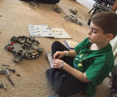 7 year old kid builds Star Wars millenium falcon LEGO set after getting tonsils removed
