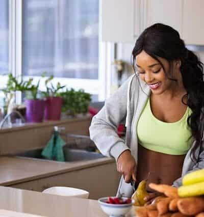woman cutting fruits in kitchen