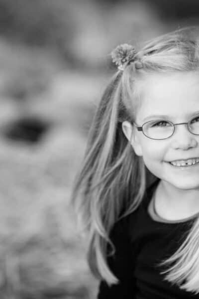black and white photo girl in glasses