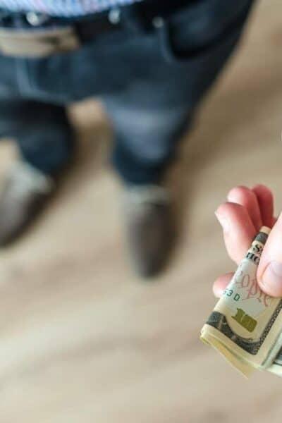 hand with money bills