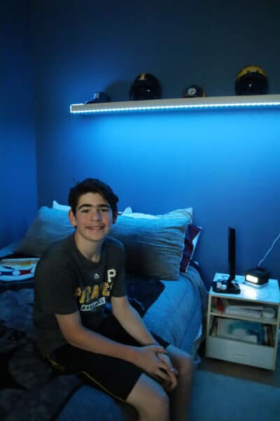 teen boys room with lights under shelf_1