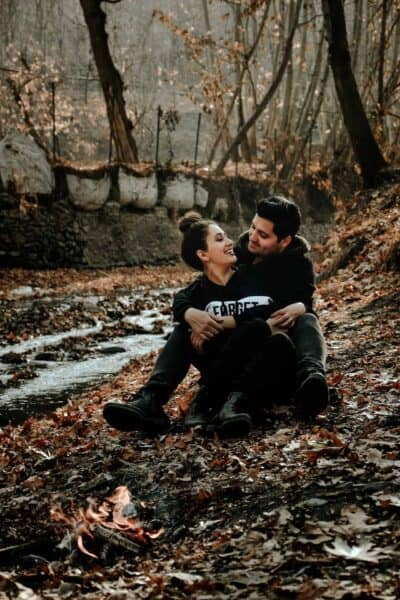 happy couple in the woods outside